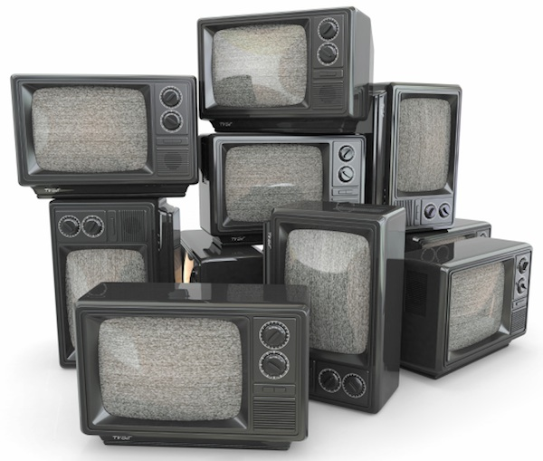 Heap of vintage TVs