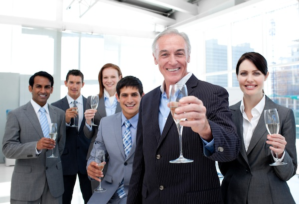 Happy diverse business group toasting with Champagne