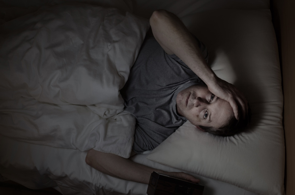 Mature man cannot fall asleep during night time